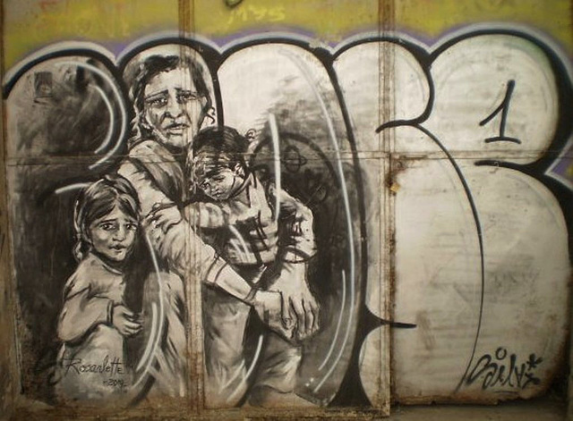 Mother and children at the door of abandoned building, by Rosarlette.