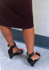 black wedge and red toes