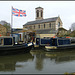 flag flying high on the canalside