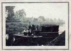 Grandparents transporting peat