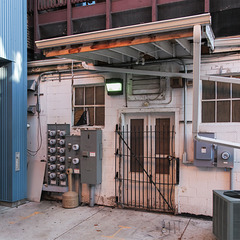 Gated doors and electric meters.