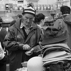 Buying a hat at Funchal Market