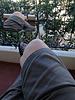 Cross-legged getting some fresh air on the balcony
