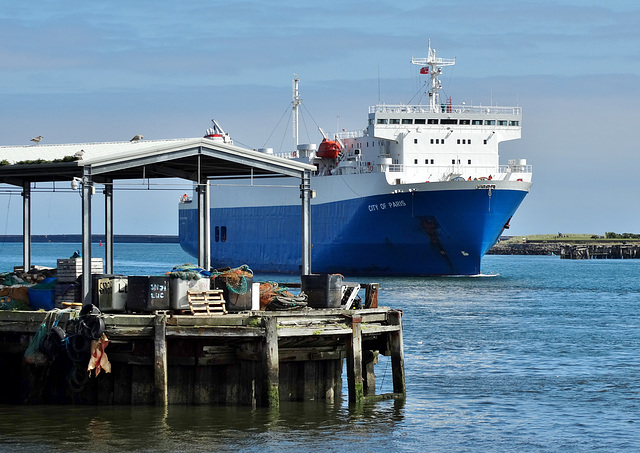 A car ferry gliding past the Fishquay