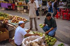 Kuala Perlis Street Market - Checking the Mangos