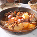 Clams with pork and potatoes in cataplana.