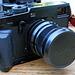 X100 lens cap fits the new 23mm