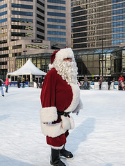 A Cincinnati Santa on ice skates.