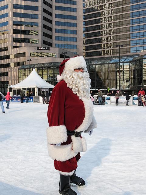 A Cincinnati Santa on ice skates.