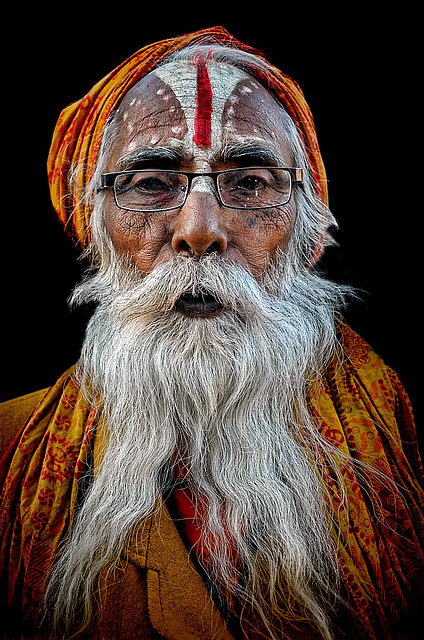old sadhu with black lips