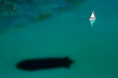 Lonely sailingboat and the zeppelin shadow