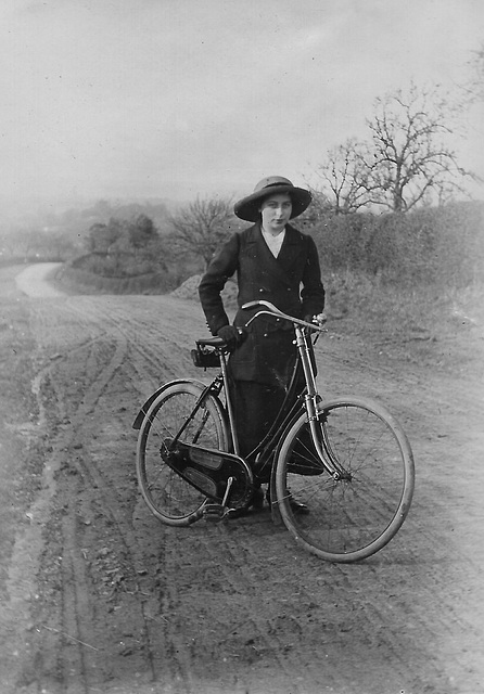 Doris Pritchard with bicycle c1909