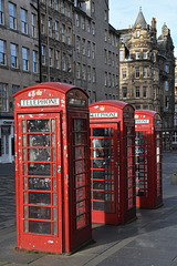Three tired looking telephone boxes