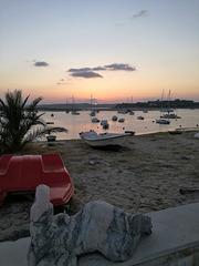 The stone mermaid will fall asleep on the Alvor Beach parapet