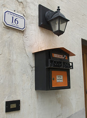 Postbox, number and lamp at Gavinana