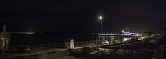 Night time panoramic view of Brixham across to Paignton