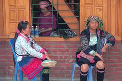 Women chat in Ta Van village