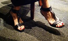wife's red toes in nine west heels