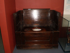 Furniture seat with toilet.