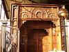 Door carved in teak wood.