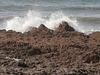 Gentle waves breaking over the rocks
