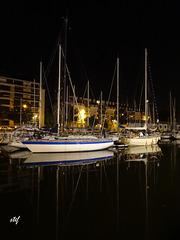 sailboats in the dark