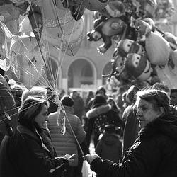 woman selling balloons