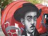 Portrait of Fernando Pessoa, painted on sidewalk ticket office.