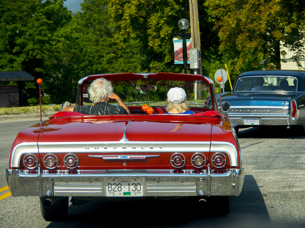 Red Chevy Impala and a Pontiac Parisienne