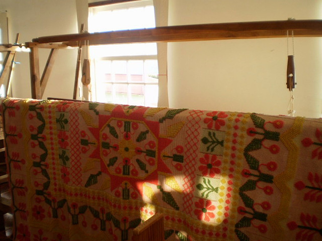Loom and 120 years old quilt.