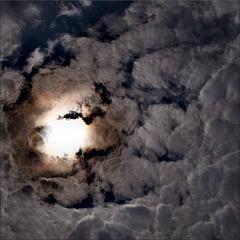 Sun in between clouds.