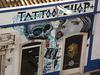Graffiti on tattoo shop.