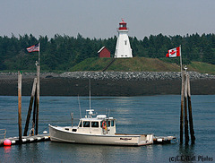 U.S. Patrol Boat & Canadian Lighthouse