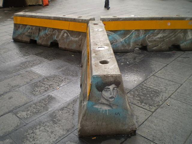 Street art on concrete barrier.