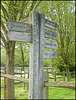 wooden path signpost