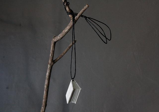 White book pendant