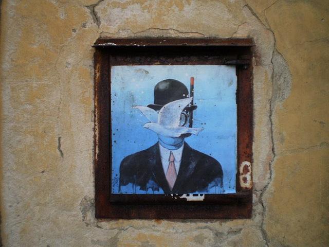 Street art on rusty wicket.