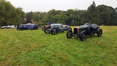 Grimsthorpe castle vintage speed trials ~  1912 Sunbeam closest to camera with a gray 1911 Wolseley beside it