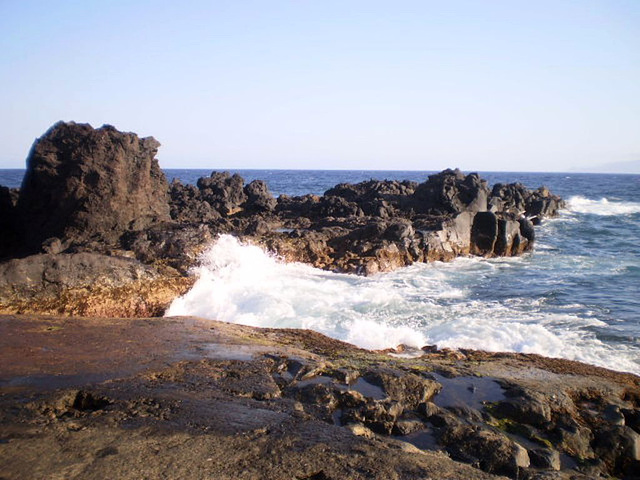 Rugged volcanic coast.