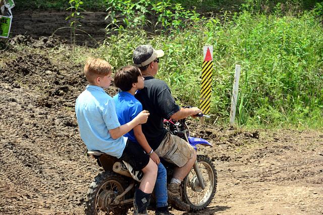 Three riders, two wheels