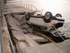 Capsized Fiat on Almada riverside.