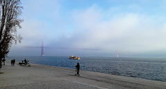 The Tagus, the fog, the boat, the bridge, the electric trottinnettes and everything...