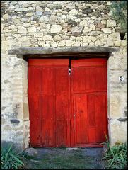 Red door. Canicosa, Segovia Province