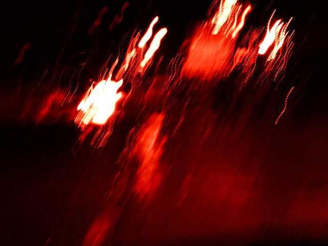 red rainy ICM on the road