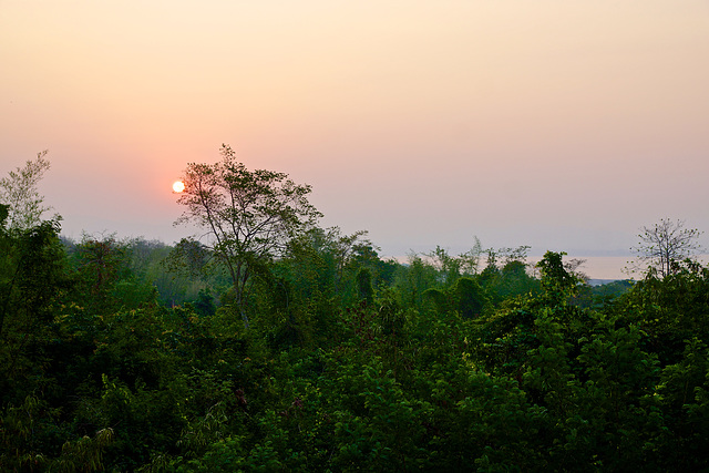 Sunrise view from one of the lodges at Huay Maekhamin waterfall base camp overlooking Srinakarin lake in Kanchanaburi province, Thailand