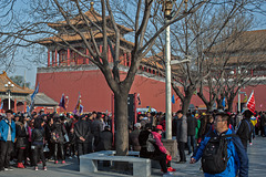 Crowd of tourists enter the Forbidden City